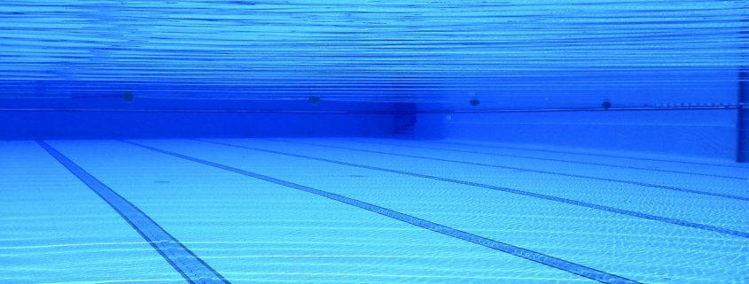 Schwimmbadbeschichtung unter Wasser